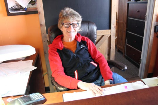 Rhonda Oord sits behind the front desk of the Corona Motel on Wednesday, April 15, 2020.