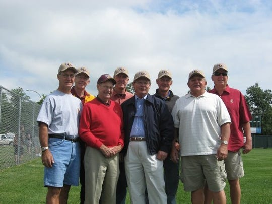 Bobby Winkles, third from left, and several of his 1969 Arizona State baseball players at the 2009 College World Series.