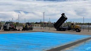 Sunland Asphalt crews work to convert the Milne Stadium parking lot in Albuquerque into a helipad on Friday, April 17, 2020.