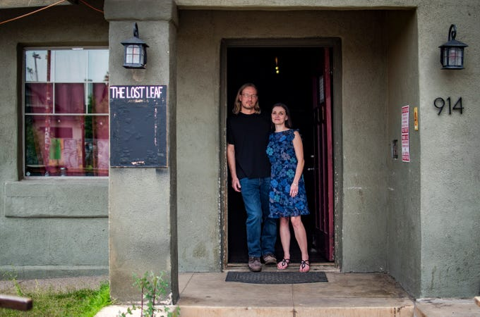 Eric and Lauren Dahl, owners of The Lost Leaf, stand for a portrait in their bar in Phoenix on April 17, 2020.