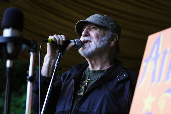 In this August 2014 photo provided by WXPN, Gene Shay performs during the Philadelphia Folk Festival. Shay, a folk DJ who spent a half-century on the Philadelphia airwaves and helped promote the careers of Bob Dylan, Joni Mitchell and countless others, has died of complications of the coronavirus. Shay, 85, who had been hospitalized in recent weeks, died Friday, April 17, 2020, according to WXPN-FM station manager Roger LaMay. (John Vettese/WXPN via AP)