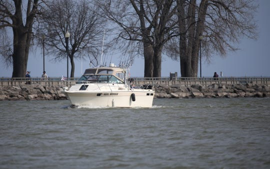 A boat comes in the Genesee River from Lake Ontario. Gov Cuomo lifted the ban so that marinas and private golf course can open.