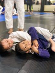 5-year-old Ethan Fuerte, chokes Elijah Tumacder, 5, during a Kugtar Mixed Martial Arts class located in Salinas, Calif.
