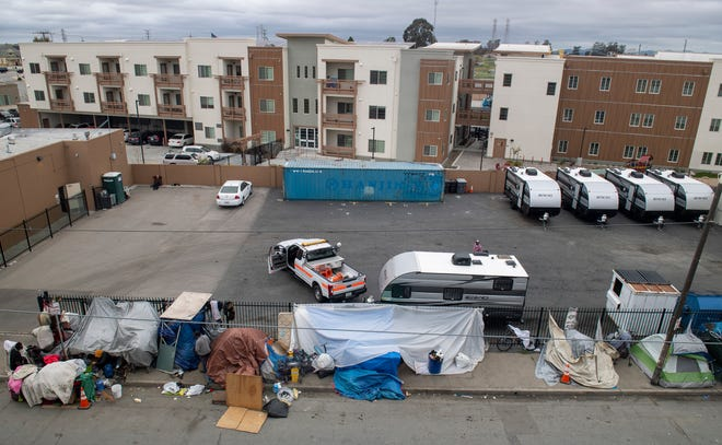 Five trailers for people experiencing homelessness are parked next to the Chinatown Navigation Center on Thursday, April 16, 2020