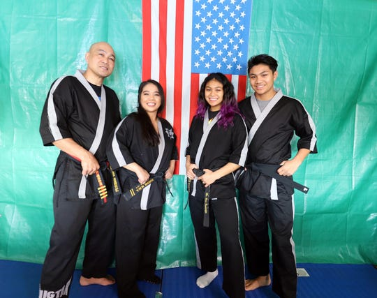 Kugtar Mixed Martial Arts instructors pose together wearing their Tang Soo Do uniforms. They are black belts in the Korean Martial Art.