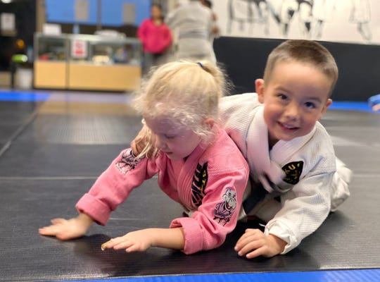 4-year-old CJ Wagner rolls with Yvonne Liddy, 4,during a Kugtar Mixed Martial Arts class located in Salinas, Calif.