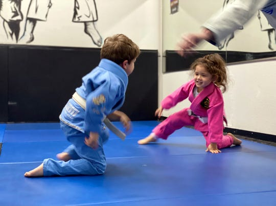 4-year-old Leo Hernandez rolls with Violet Carillo ,4, during a Kugtar Mixed Martial Arts class located in Salinas, Calif.