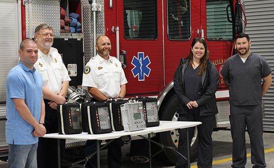 TMH accepts donation of ventilators from Wakulla County Fire and Rescue. From left: Colby Redfield, MD, emergency medicine physician at TMH, Marvin Walters, WCFR EMS Chief, Louis Lamarche, WCFR Fire Chief, Allison Peters, RRT/Chronic Lung Disease Navigator at TMH and Justin Posey, BS, RRT/Respiratory Care Manager at TMH.