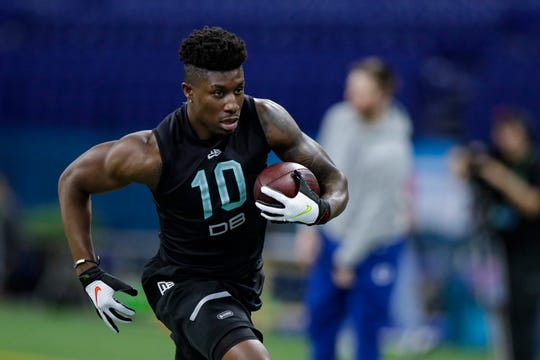 TCU defensive back Jeff Gladney runs a drill at the NFL football scouting combine in Indianapolis, Sunday, March 1, 2020. (AP Photo/Michael Conroy)