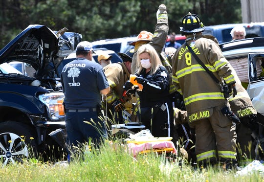 A Lifeflight worker wears a mask while helping at scene of a head-on collision on Shirley Store Road in Anderson County just south of Anderson, Monday, April 20, 2020.