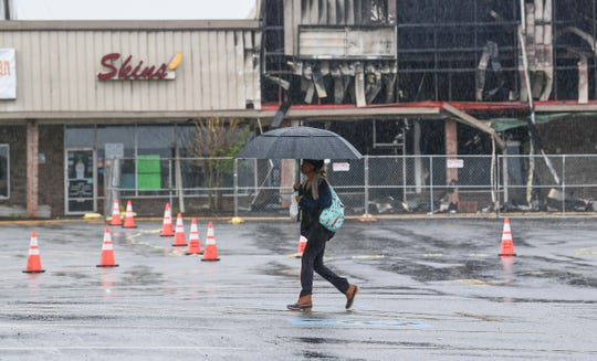 An employee walks to Joann Fabrics and Craft near Market Place mall Monday morning. The craft store is open, but only allows a few people at a time.