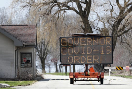 Closed sign at the entrance to High Cliff State Park is seen on Tuesday, April 14, 2020, in Sherwood, Wis.