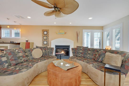 The family room offers hardwood floors and recessed lights.