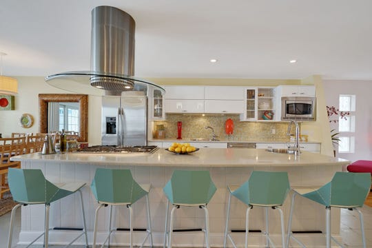 The Kitchen feature custom cabinetry and granite stone counters.