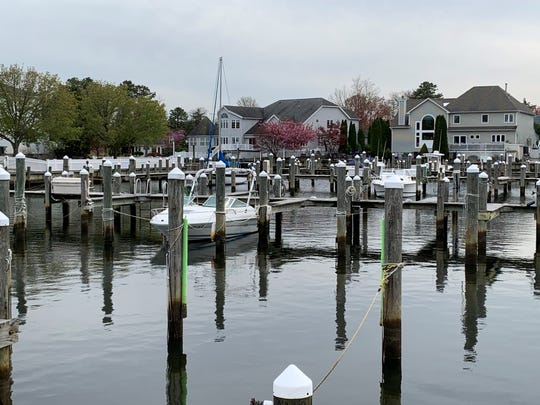 A few boats and sailboats are in their slips at Sailor's Quay Marina in Brick on April 20, 2020.