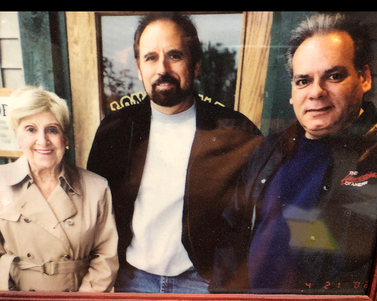 Dennis Traverso (middle) and James Traverso (right) with their mom Mary in an undated photo.