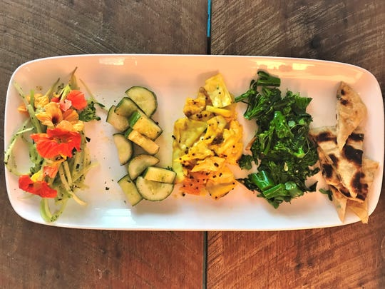 On the menu at Cucina 24 recently: an appetizer platter of Asian-influenced vegetable dishes, arranged on a platter by the reporter.