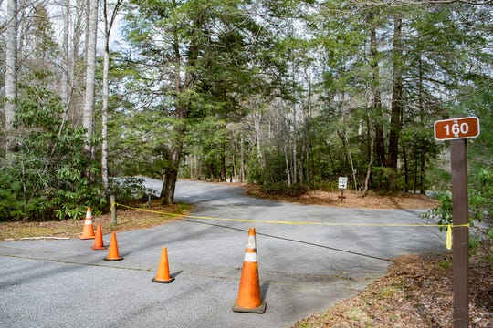 Cones and caution tape block off the parking lot at the Pink Beds trailhead and picnic area in the Pisgah National Forest on April 7, 2020. Most of the forest is now closed to help slow the spread of COVID-19.