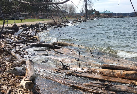 Wind and waves batter Burlington's waterfront along a stretch of the Greenway trail at Perkins Pier on April 19, 2020. This view is looking south, toward the city's wastewater treatment plant.