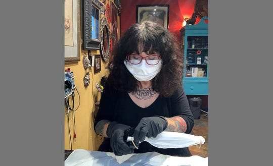 Sue Moerder, owner of Moerder Tattoos and Gallery, has made over 600 masks using non-fiberglass HEPA vacuum bags.
