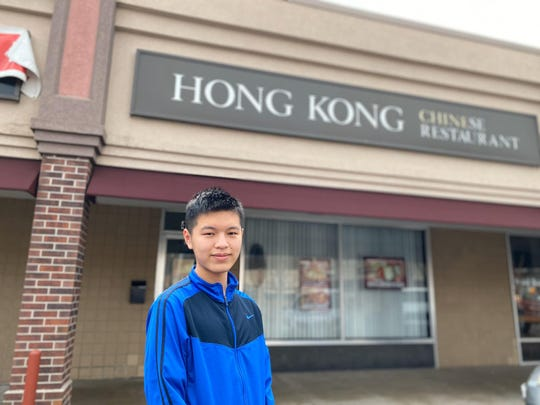 Xiangheng Li, 19, helps out at his family's restaurant — Hong Kong Chinese Restaurant —in Des Moines' Drake neighborhood where a customer left after learning his mother was Chinese.