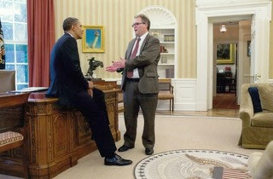 President Barack Obama talks with Douglas Burns, co-owner of the Carroll Times Herald and Jefferson Herald, about economic development in rural Iowa and other pressing issues for the Hawkeye State in the Oval Office in the summer of 2012.