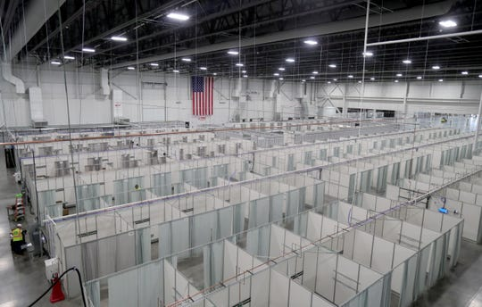 Beds set up at the Suburban Collection Showplace in April. The state announced it was putting the center on pause as the number of coronavirus hospitalizations declined across the region.
