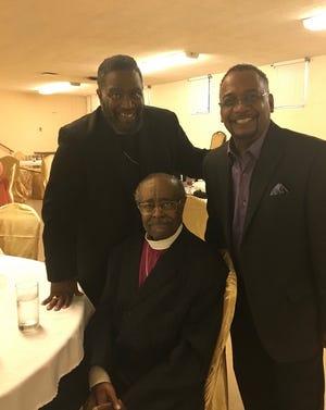 Bishop C.L. Morton Jr. (center) as the guest speaker at Bishop James A. Williams II (left) 22nd pastoral anniversary in 2019.