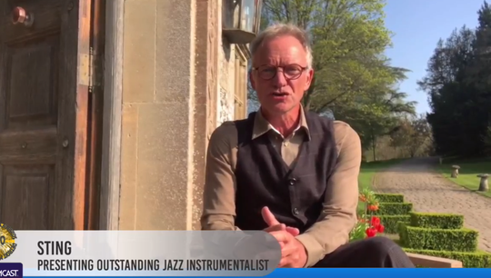 Sting presents the award for outstanding jazz instrumentalist (bassist Takashi Iio) on the Detroit Music Awards streaming show on April 19, 2020.