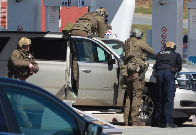 Royal Canadian Mounted Police officers surround a suspect at a gas station Sunday in Enfield, Nova Scotia. Canadian police say multiple people are dead plus the suspect after a shooting rampage across the province of Nova Scotia. It was the deadliest shooting in Canada in 30 years.