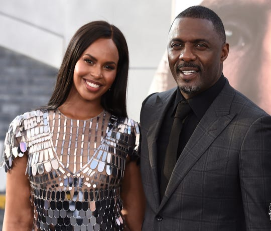 British actor Idris Elba says he and his wife Sabrina Dhowre, left, had their lives' turned around after contracting the coronavirus.