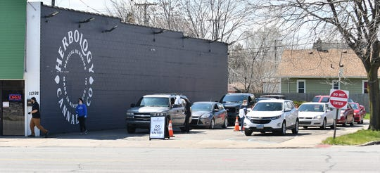 Two drive-thru lines formed Monday at Herbology Cannabis Co. in River Rouge.