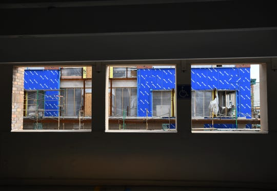 More construction is framed through the windows of the parking structure on 11 mile, east of Main Street in Royal Oak, Michigan on April 14, 2020.