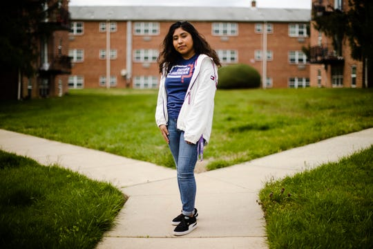 In this Friday, April 3, 2020 photo, Anali Reyes Vazquez a senior at Rutgers University poses for a photograph in Barrington, N.J.