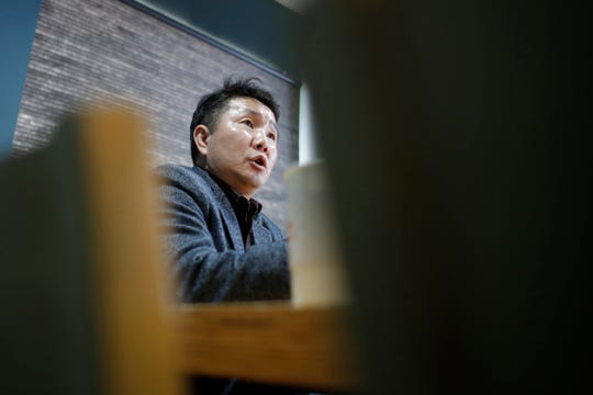 In this April 2, 2020, photo, Choi Jung Hun, a former North Korean doctor who came to South Korea in 2012, speaks during an interview with The Associated Press in Seoul, South Korea.