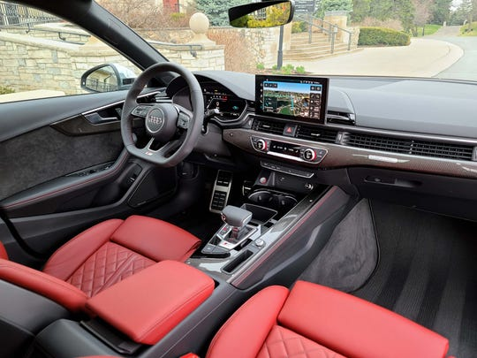 The interior of the 2020 Audi S4 is a comfortable sanctuary, especially in red leather seats. Its conservative like a Brooks Brothers suit compared to the Alfa's curvier Italian  lines.