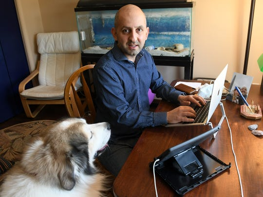 Dr. Arash Javanbakht, a psychiatrist, offers online sessions with patients from his Ypsilanti home during the pandemic. His dog Jasper sometimes sits in on therapy sessions.