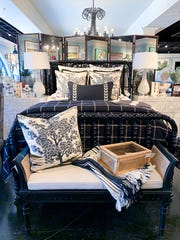 On this bold bed, the black window pane plaid pops on top of a simple white coverlet.