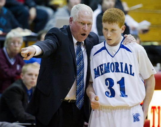 Memorial head coach Rick Wilgus gives instruction to guard Brandon Auker in the second half of their Boys 3A Sectional basketball game held at Princeton Community Middle School on Tuesday night, March 1, 2011.