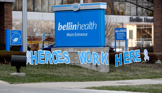 """Heroes work here"" on display in front of Bellin Hospital on April 18, 2020, in Green Bay, Wis."