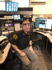 Kewaunee County Deputy Mark Jandrin models one of the 25-plus plastic face masks donated to the Sheriff's Department by Tim Rueckl of Luxemburg, who made the masks on his 3-D printer.