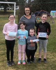 Amber Massart and her children, Braelyn, Brooklyn, Bentley and Brystol, with some of the personal protective equipment items they donated to the Kewaunee County Sheriff's Department.