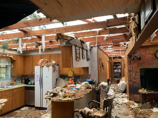 The home of Penny and Brian Temples sustained heavy damage after a tornado ripped off the roof of their Baxterville, Mississippi, home on Sunday, April 19, 2020.