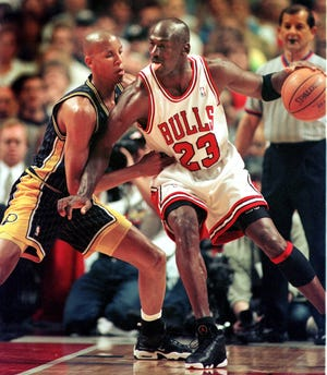 5/17/98 --- Pacers Reggie Miller plays tight defence on Chicago's Michael Jordan in the first half of game 1 of the Eastern Conference Finals Sunday afternoon in Chicago.
