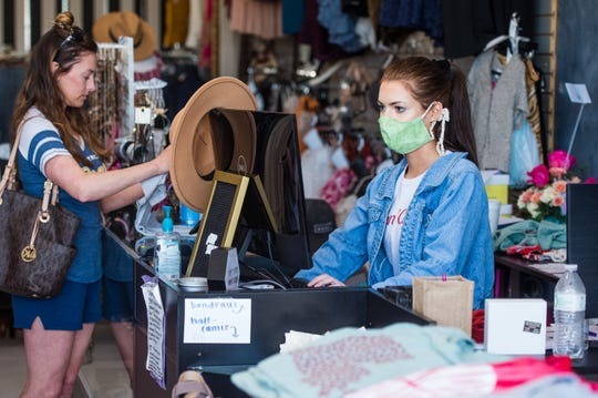 Kelsie Judice at Shoetique on Hector Connoly Rd in Carencro is looking forward to opening after the new rules have been put in place for some businesses to reopen. Monday, April 20, 2020.