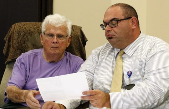 Former Fairfield County Board of Elections member W. Allan Reid, left, and current member Kyle Farmer are shown here during an elections board hearing in 2018. Reid died on Friday and Farmer said Reid was one of his political mentors.