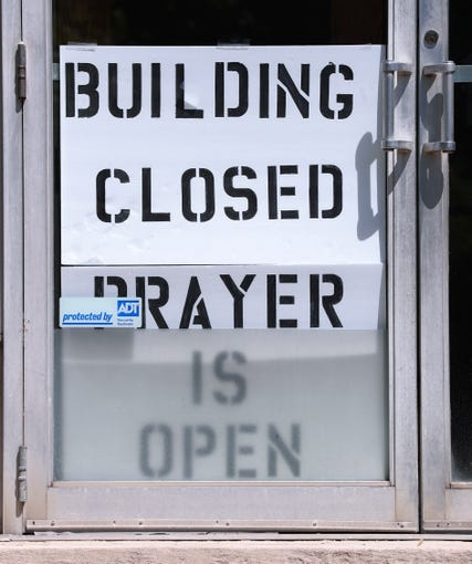 The Brown Memorial CME Church has a sign out front announcing that building is closed to worship due to the coronavirus pandemic in Louisville, Ky. on April 20, 2020.  However they are continuing worship services online.