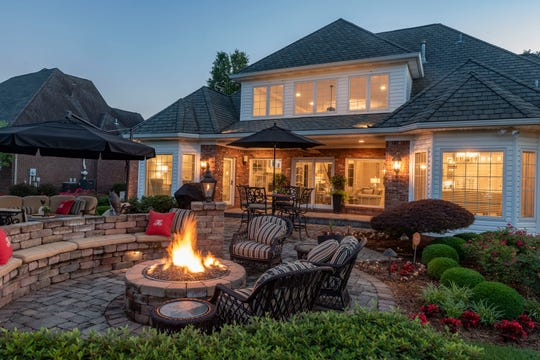 The backyard features a firepit with ample seating.