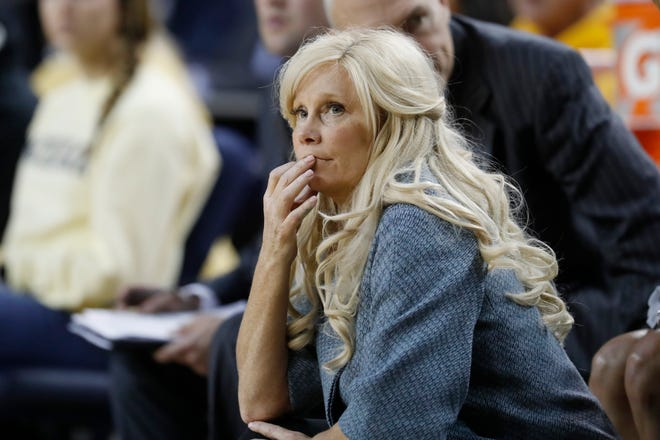 Michigan State head coach Suzy Merchant watches during the second half of an NCAA college basketball game against Michigan, Sunday, Jan. 5, 2020, in Ann Arbor, Mich. (AP Photo/Carlos Osorio)