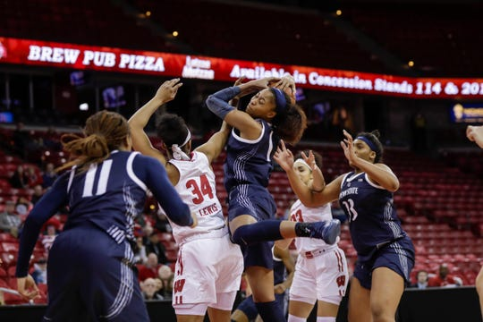 Penn State's Alisia Smith (cemter) and Wisconsin's Imani Lewis (34) battle for a rebound during the second half of a game in 2019. Smith, a Waverly graduate, has transferred to Michigan State.